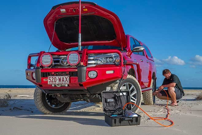An air compressor is valuable for sand driving