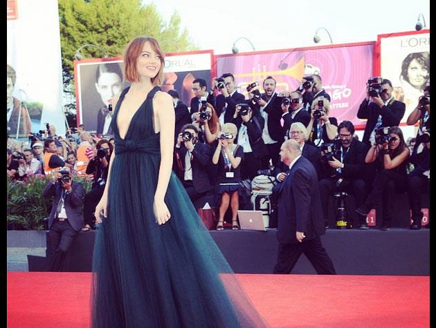 Emma Stone debuted her chin-length cut in a gorgeous Valentino gown at the Venice Film Festival.