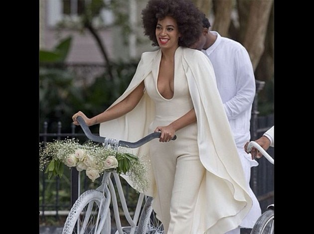 She wore this cream pantsuit to ride a vintage bike to the wedding. Image: Instagram