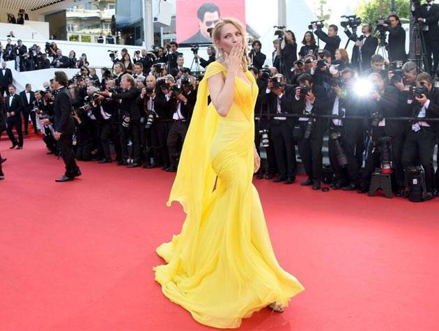 Actress Uma Thurman is the picture of elegance in this sunshine-yellow Atelier Versace gown. Image: Twitter
