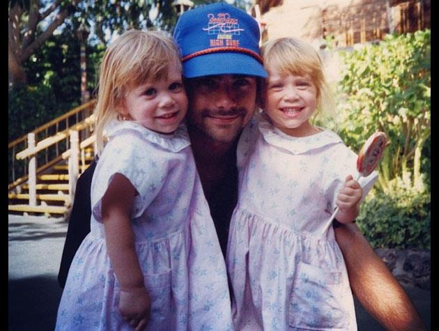 John Stamos shared this throwback to the *Full House* days with adorable Mary-Kate and Ashley Olsen.
