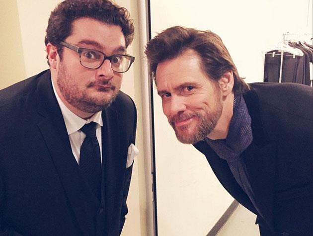 Jim Carrey takes a photo with current SNL cast member Bobby Moynihan.