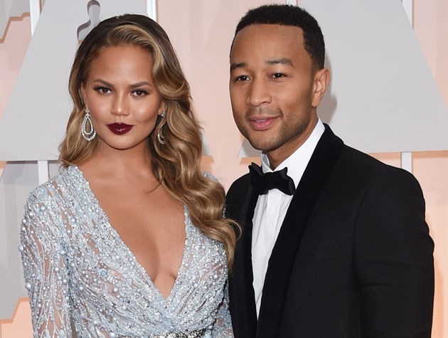 Chrissy Teigen offered up a one-two punch of luscious curls and that gorgeous deep red lipstick.