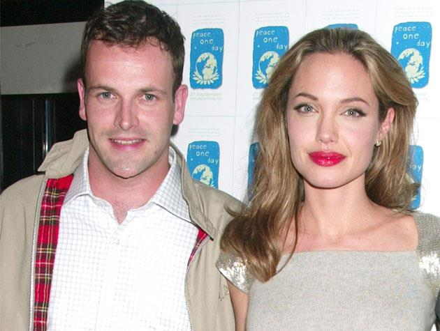 """Before she married (and subsequently split from) Brad Pitt, Angelina Jolie got hitched to her *Hackers* costar Jonny Lee Miller for 18 months in 1996. Nowadays, Ange says he's still """"a great friend""""."""