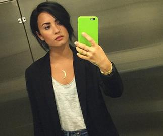 Demi Lovato covers up raunchy tattoo