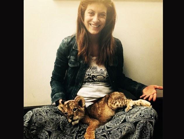 Kate Walsh cuddled up to a tiny jaguar!
