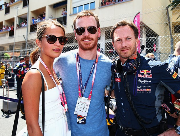 Michael Fassbender and Alicia Vikander with Red Bull Racing's Christian Horner.