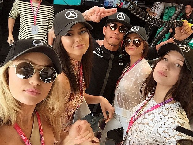 Formula 1 racer Lewis Hamilton gets support from famous friends Gigi and Bella Hadid, Kendall Jenner and Hailey Baldwin.
