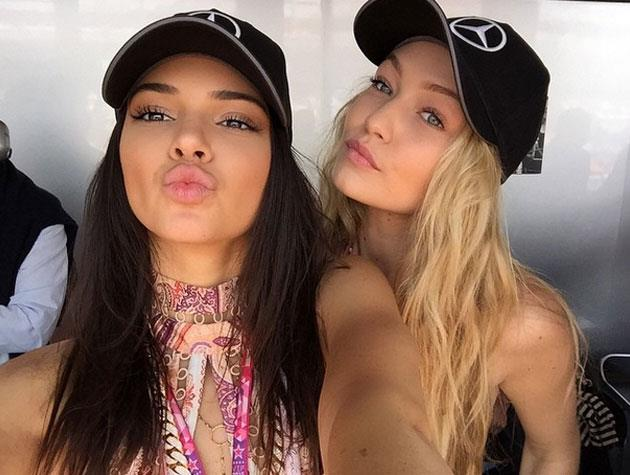 Gigi and Kendall pause for a selfie at the Grand Prix.